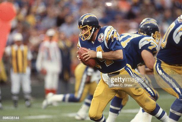 Dan Fouts of the San Diego Chargers circa 1987 drops back to pass against the Miami Dolphins at Jack Murphy stadium in San Diego California