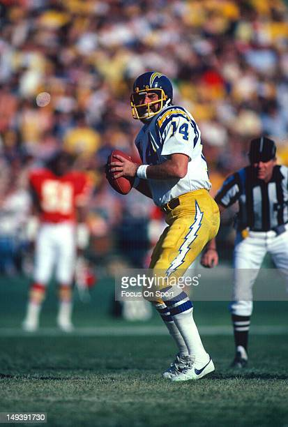 Dan Fouts of the San Diego Chargers drops back to pass against the Kansas City Chiefs during an NFL football game circa 1980 at Jack Murphy Stadium...