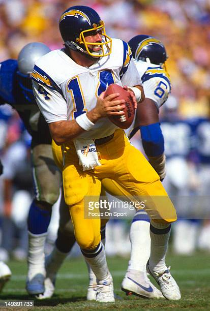 Dan Fouts of the San Diego Chargers drops back to pass against the Seattle Seahawks during an NFL football game circa 1980 at Jack Murphy Stadium in...