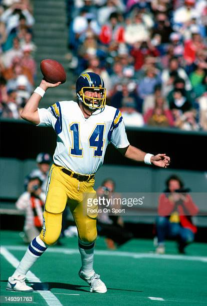 Dan Fouts of the San Diego Chargers drops back to pass against the Cincinnati Bengals during an NFL football game November 2 1980 at Riverfront...