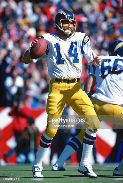 Dan Fouts of the San Diego Chargers drops back to pass against the New England Patriots during an NFL football game October 16 1983 at Sullivan...