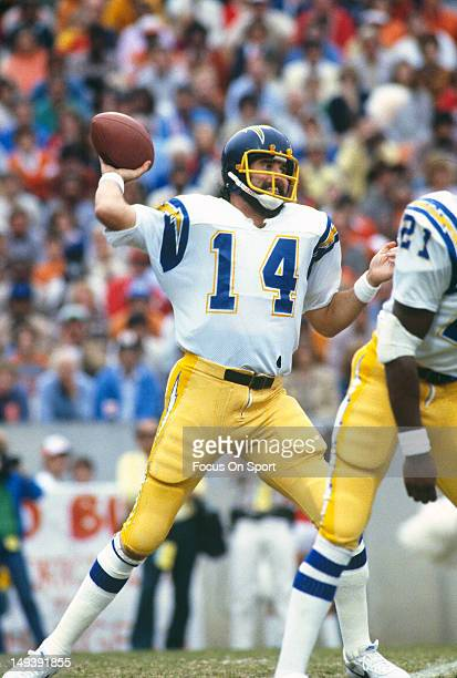 Dan Fouts of the San Diego Chargers drops back to pass against the Tampa Bay Buccaneers during an NFL football game December 3 1981 at Tampa Stadium...