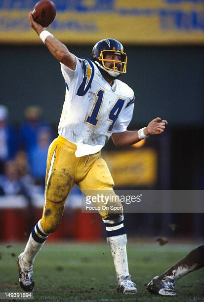 Dan Fouts of the San Diego Chargers drops back to pass against the Denver Broncos during an NFL football game circa 1980 at Jack Murphy Stadium in...