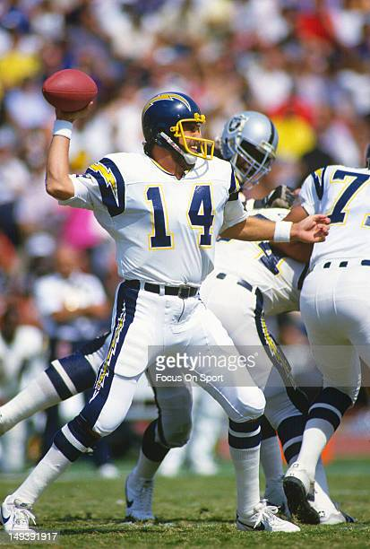 Dan Fouts of the San Diego Chargers drops back to pass against the Los Angeles Raiders during an NFL football game September 28 1986 at the Los...