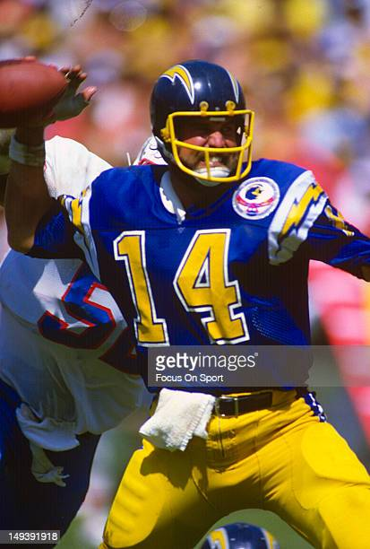 Dan Fouts of the San Diego Chargers drops back to pass against the Houston Oilers during an NFL football game September 16 1984 at Jack Murphy...