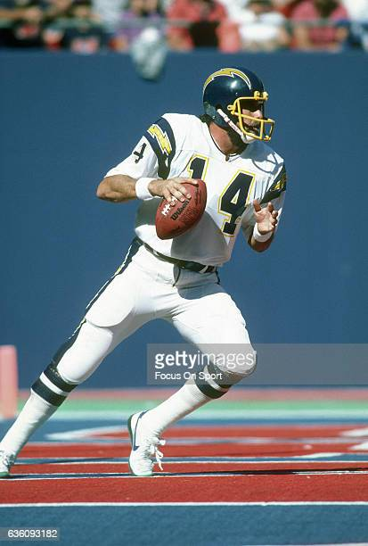 Dan Fouts of the San Diego Chargers drops back to pass against the New York Giants during an NFL football game September 14 1986 at The Meadowlands...