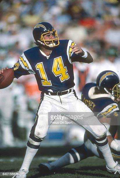 Dan Fouts of the San Diego Chargers drops back to pass against the Philadelphia Eagles during an NFL football game December 15 1985 at Jack Murphy...