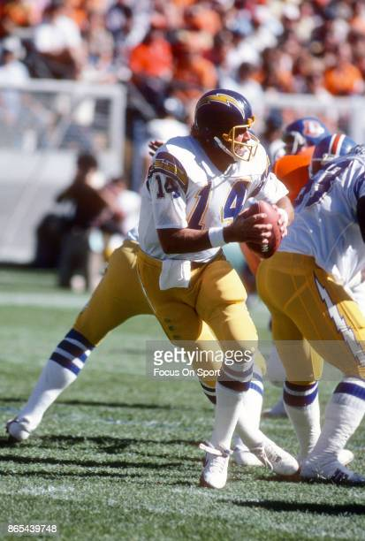 Dan Fouts of the San Diego Chargers drops back to pass against the Denver Broncos during an NFL football game September 27 1981 at Mile High Stadium...