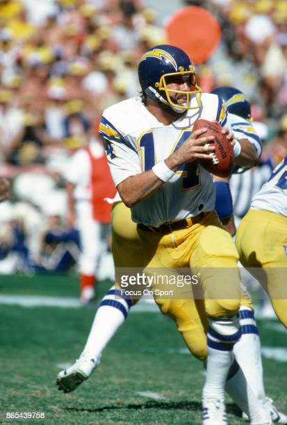 Dan Fouts of the San Diego Chargers drops back to pass against the Seattle Seahawks during an NFL football game October 14 1979 at Jack Murphy...