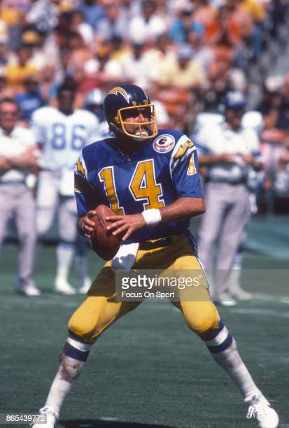 Dan Fouts of the San Diego Chargers drops back to pass against the Detroit Lions during an NFL football game September 30 1984 at Jack Murphy Stadium...