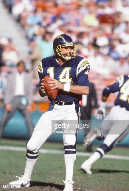 Dan Fouts of the San Diego Chargers drops back to pass against the Indianapolis Colts during an NFL football game December 20 1987 at Jack Murphy...