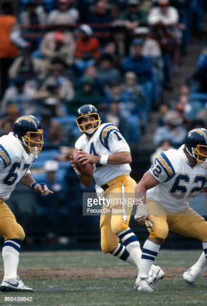 Dan Fouts of the San Diego Chargers drops back to pass against the Baltimore Colts during an NFL football game October 18 1981 at Memorial Stadium in...