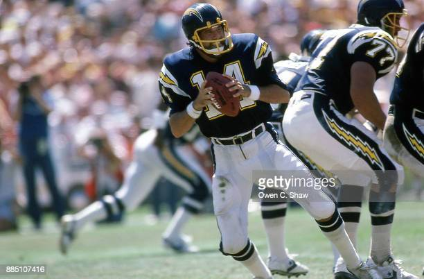 Dan Fouts of the San Diego Chargers drop[s back to pass at Jack Murphy Stadium circa 1985 in San DiegoCalifornia