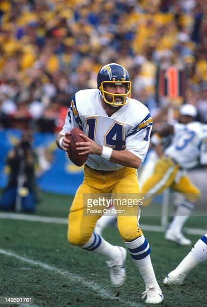 Dan Fouts of the San Diego Chargers drops back to pass during an NFL football game circa 1980 at Jack Murphy Stadium in San Diego California Fouts...