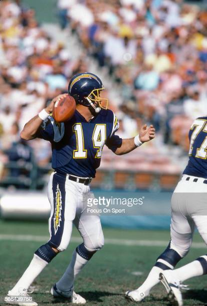 Dan Fouts of the San Diego Chargers drops back to pass during an NFL football game circa 1980 at Jack Murphy Stadium in San Diego California