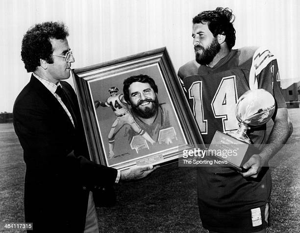 Dan Fouts of the San Diego Chargers is presented with a painting of himself circa 1980s