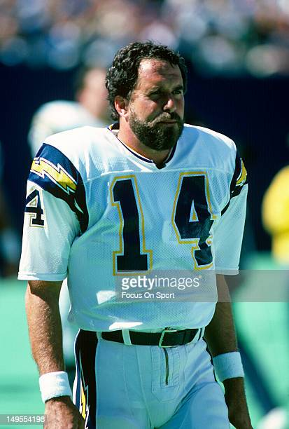 Dan Fouts of the San Diego Chargers looks on during warm ups before the start of an NFL football game circa 1986 Fouts played for the Chargers from...
