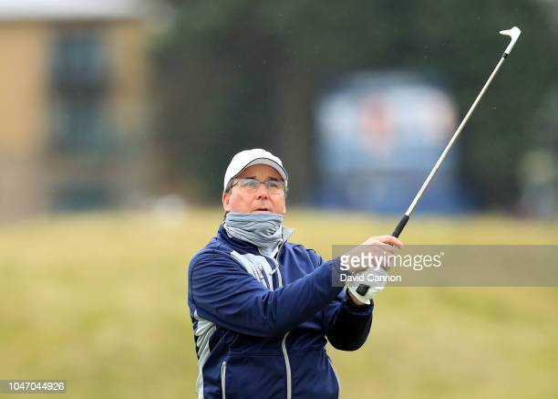 Dan Friedkin of the United States the amateur playing partner of Lucas Bjerregaard plays his second shot on the fourth hole during the final round of...