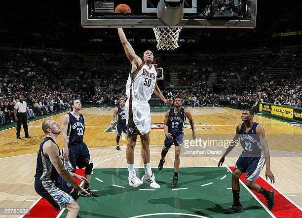 Dan Gadzuric of the Milwaukee Bucks attempts a dunk against the Memphis Grizzlies December 8 2006 at the Bradley Center in Milwaukee Wisconsin NOTE...