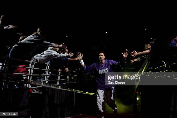 Dan Gadzuric of the Milwaukee Bucks greets fans as he comes out of the tunnel during player introductions against the Miami Heat during a NBA game...