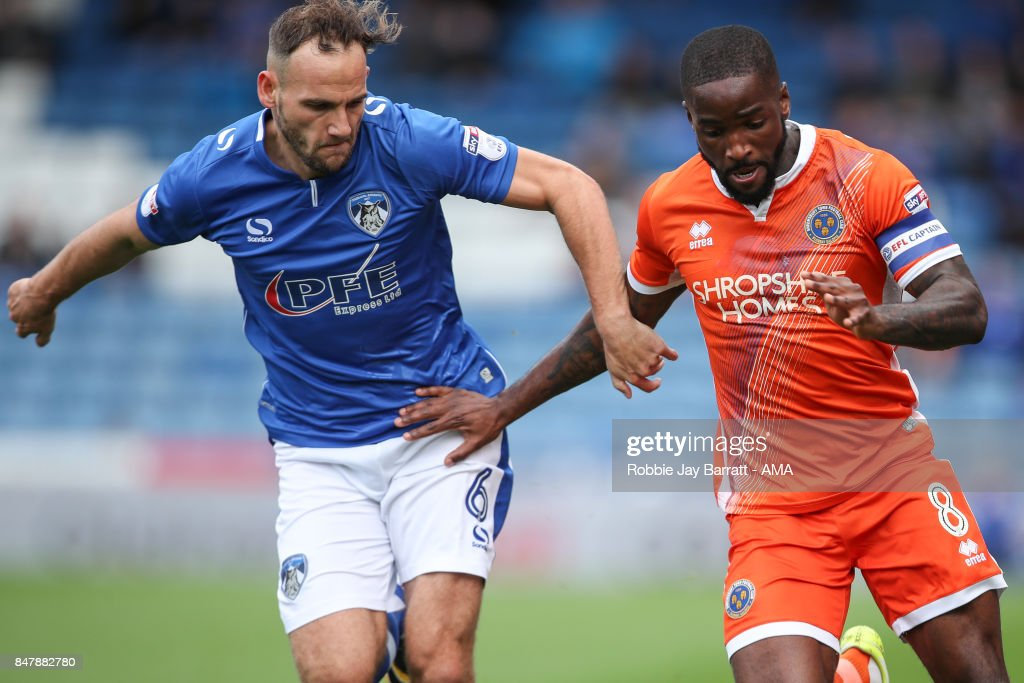 Dan Gardner of Oldham Athletic and Abu Ogogo of Shrewsbury Townduring the Sky Bet League One match between Oldham Athletic and Shrewsbury Town at Boundary Park on September 16, 2017 in Oldham, England.