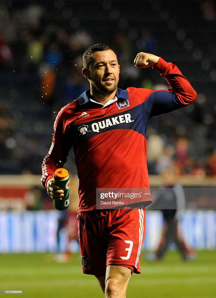 Dan Gargan #3 of Chicago Fire flexes for the crowd after the Fire Defeated the Montreal Impact in an MLS match on September 15, 2012 at Toyota Park in Bridgeview, Illinois. The Chicago Fire defeated the Montreal Impact 3-1.