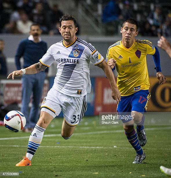 Dan Gargan of Los Angeles Galaxy beats Dillon Serna of Colorado Rapids to the ball during Los Angeles Galaxy's match against the Colorado Rapids at...