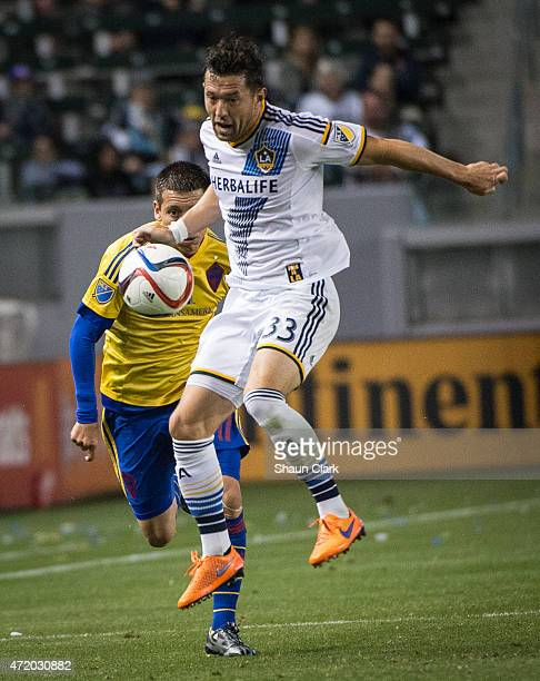 Dan Gargan of Los Angeles Galaxy cuts off a pass intended for Dillon Serna of Colorado Rapids during Los Angeles Galaxy's match against the Colorado...