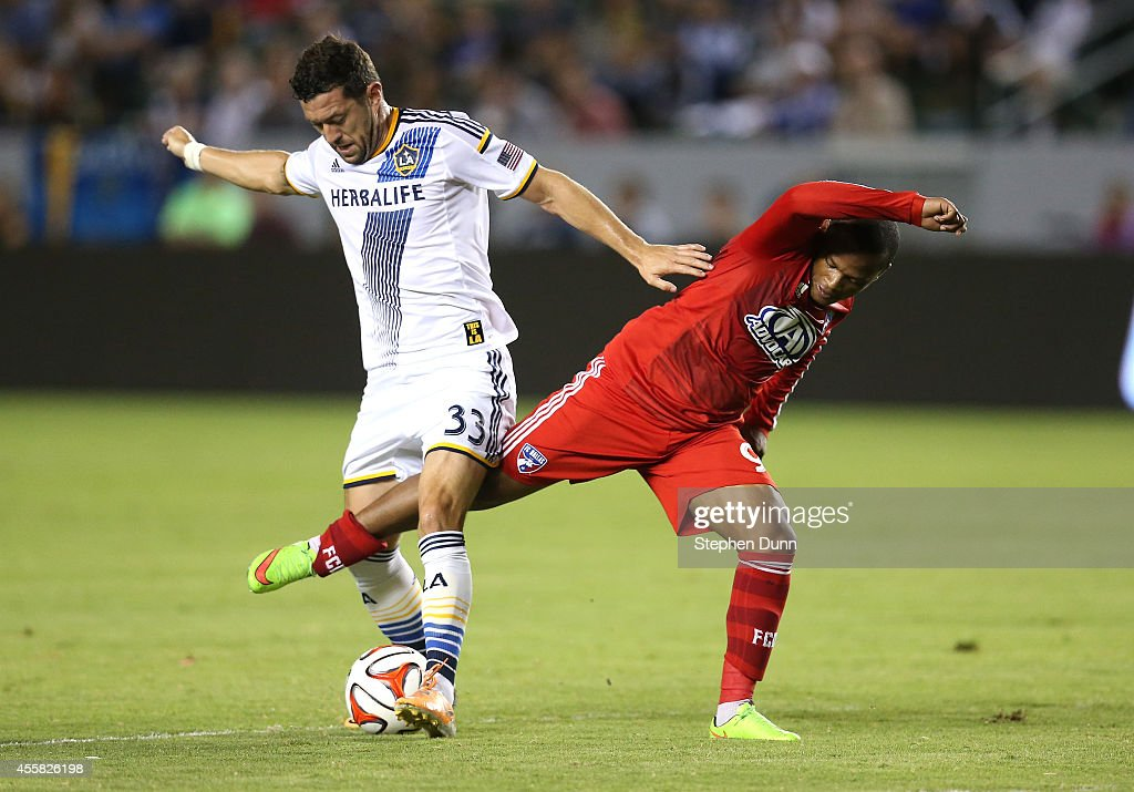 Dan Gargan #33 of the Los Angeles Galaxy battles for the ball against Andres Escobar #91 of FC Dallas at StubHub Center on September 20, 2014 in Los Angeles, California.