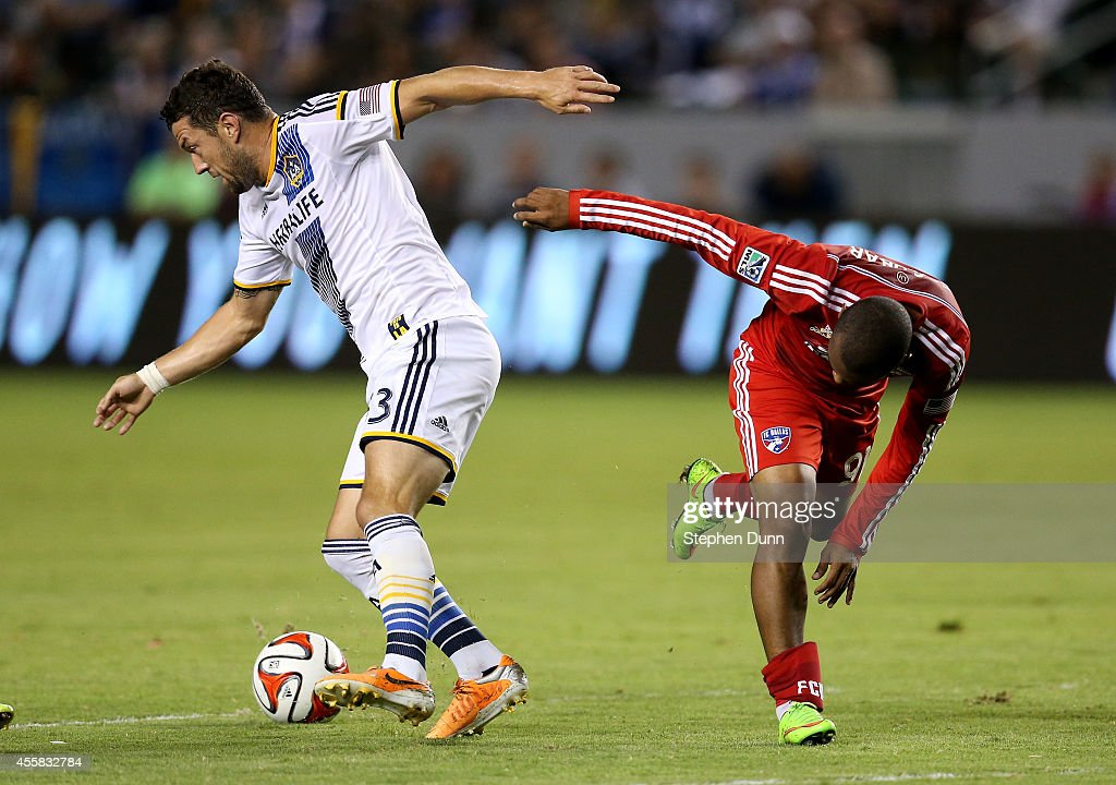 Dan Gargan #33 of the Los Angeles Galaxy wins the ball against Andres Escobar #91 of FC Dallas at StubHub Center on September 20, 2014 in Los Angeles, California.