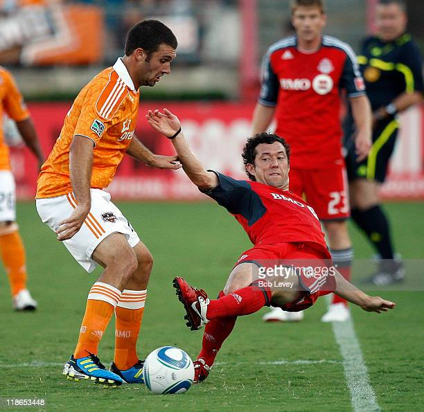Dan Gargan of Toronto FC clears the ball before he goes out of bounds as Will Bruin of the Houston Dynamo applies some pressure at Robertson Stadium...
