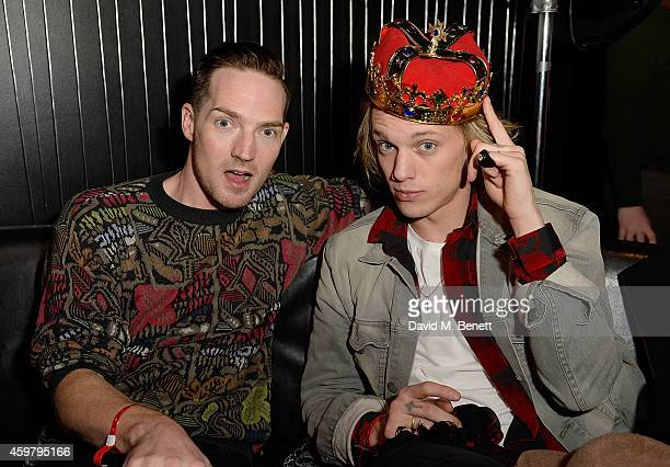Dan Gillespie Sells and Jamie Campbell Bower attend the W London Leicester Square World AIDS Day Fundraising Party at Wyld on December 1 2014 in...