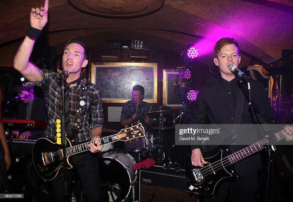 Dan Gillespie Sells and Richard Jones from The Feeling perform at the 50th Birthday Celebration of Annabel's Nightclub on September 27, 2013 in London, England.
