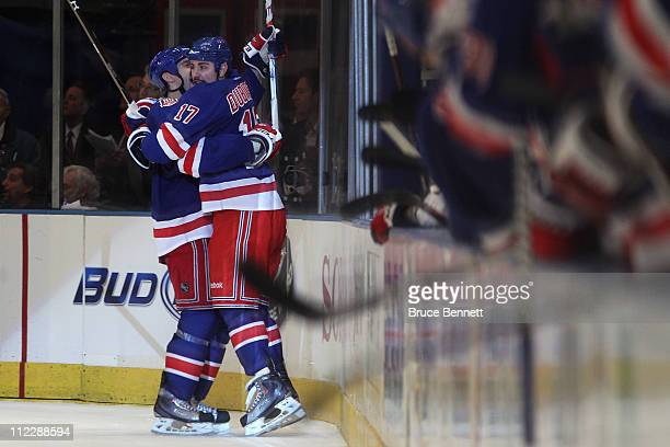 Dan Girardi and Brandon Dubinsky of the New York Rangers celebrate after Dubinsky scored the game winning goal in the third period against the...