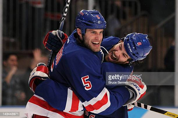 Dan Girardi and Brandon Prust of the New York Rangers celebrate Girardi's second period goal against the Ottawa Senators in Game Seven of the Eastern...