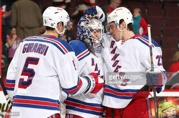 Dan Girardi, Henrik Lundqvist and Ryan McDonagh of the New York Rangers celebrate their win over the Ottawa Senators at Canadian Tire Centre on March...