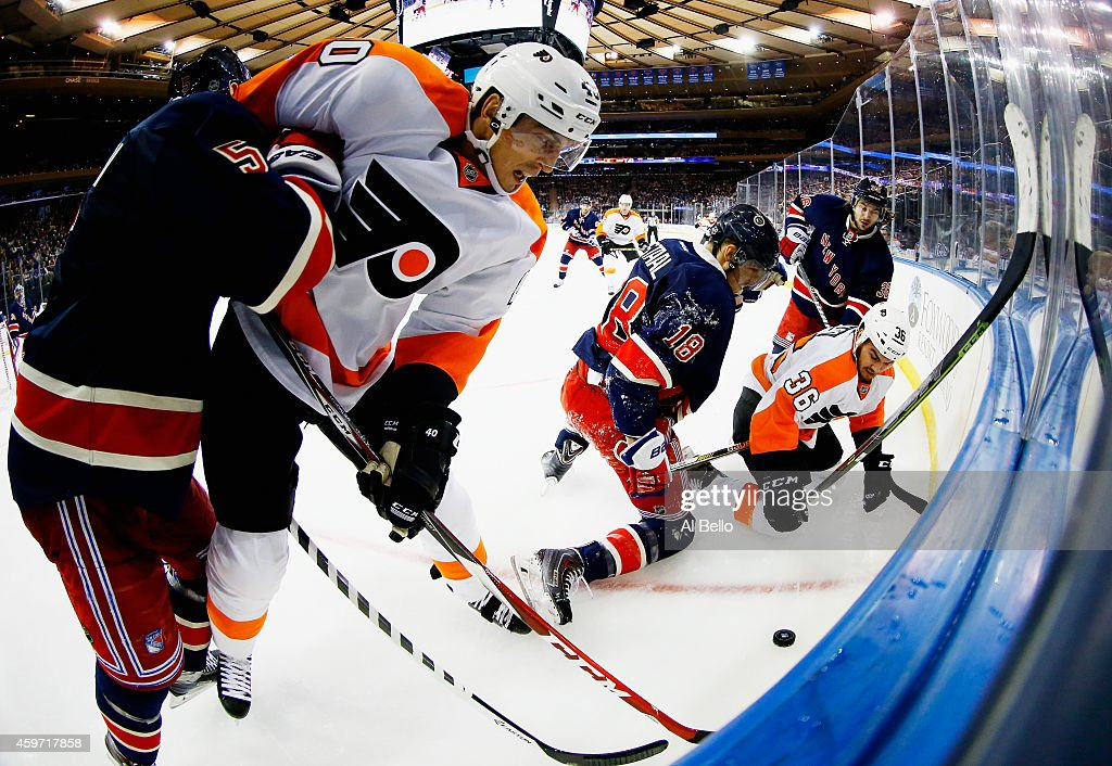Dan Girardi #5, Marc Staal #18, and Mats Zuccarello #36 of the New York Rangers battle Vincent Lecavalier #40, and Zac Rinaldo #36 of the Philadelphia Flyers during their game at Madison Square Garden on November 29, 2014 in New York City.
