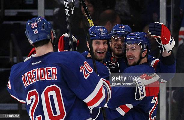 Dan Girardi of the New York Rangers celebrates his third period goal with teammates Derek Stepan Chris Kreider and Marian Gaborik of the New York...