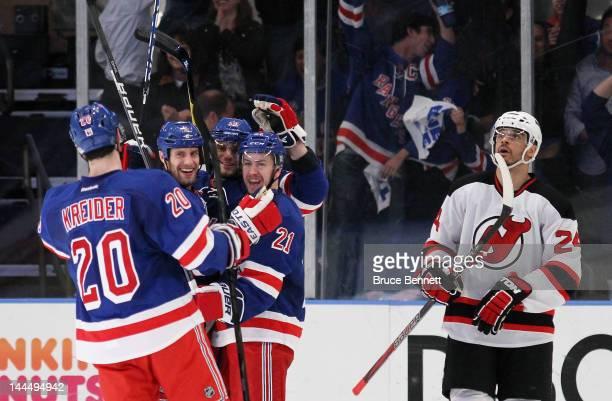 Dan Girardi of the New York Rangers celebrates ihs third period goal with teammates Derek Stepan Chris Kreider and Marian Gaborik of the New York...