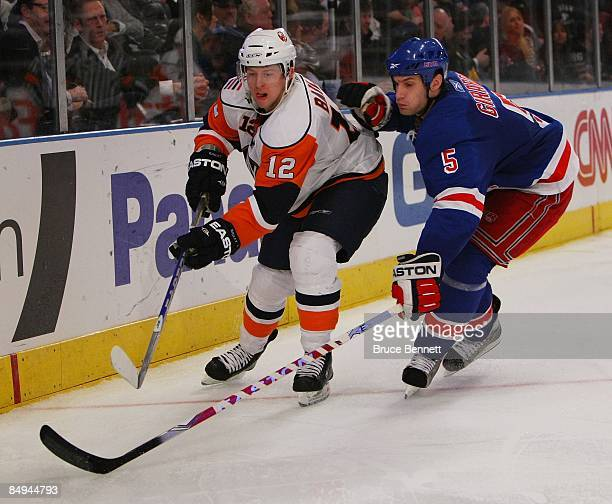Dan Girardi of the New York Rangers checks Josh Bailey of the New York Islanders on February 18 2009 at Madison Square Garden in New York City