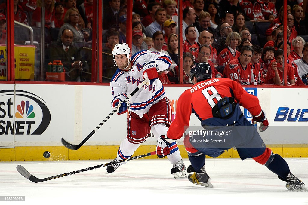 Dan Girardi #5 of the New York Rangers dumps the puck into the zone during the first period of Game Five of the Eastern Conference Quarterfinals during the 2013 NHL Stanley Cup Playoffs against the Washington Capitals at Verizon Center on May 10, 2013 in Washington, DC.