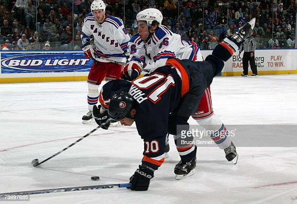 Dan Girardi of the New York Rangers upends Andy Hilbert of the New York Islanders on March 25 2007 at the Nassau Coliseum in Uniondale New York