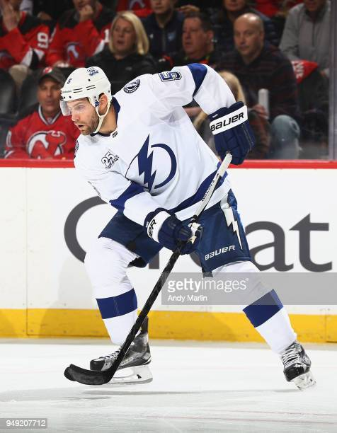 Dan Girardi of the Tampa Bay Lightning plays the puck against the New Jersey Devils in Game Four of the Eastern Conference First Round during the...