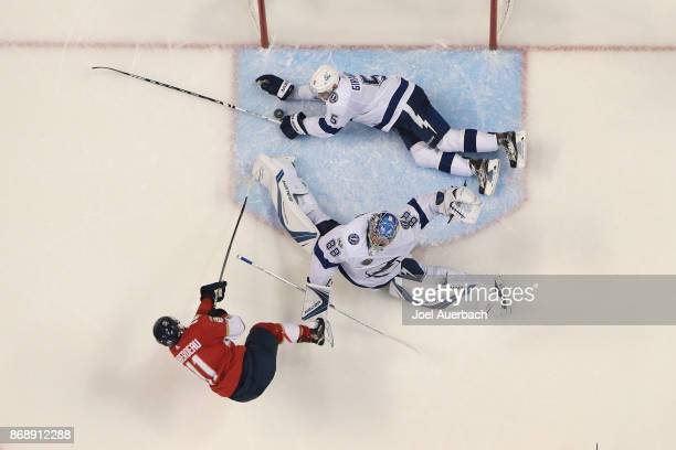 Dan Girardi of the Tampa Bay Lightning saves a goal after the shot by Jonathan Huberdeau of the Florida Panthers gets past goaltender Andrei...