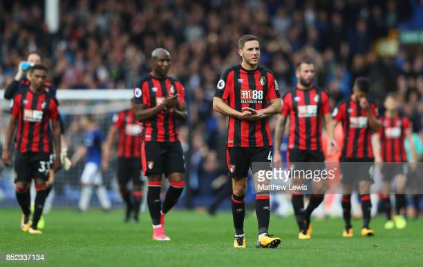 Dan Gosling and AFC Bournemouth players applauds travelling supporters after their 12 defeat in the Premier League match between Everton and AFC...