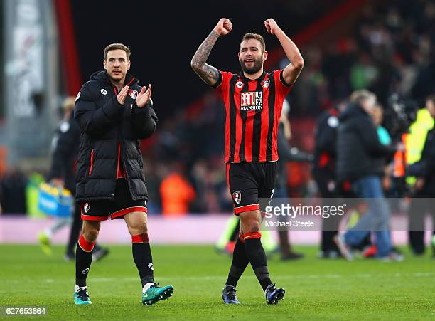 Dan Gosling and Steve Cook of AFC Bournemouth celebrate victory the Premier League match between AFC Bournemouth and Liverpool at Vitality Stadium on...