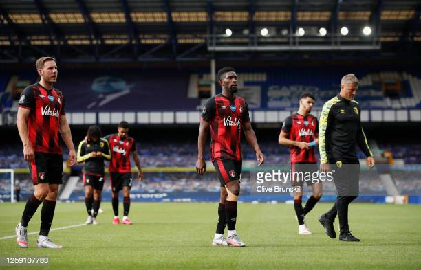 Dan Gosling Jefferson Lerma and Dominic Solanke of AFC Bournemouth looks dejected after being relegated after the Premier League match between...