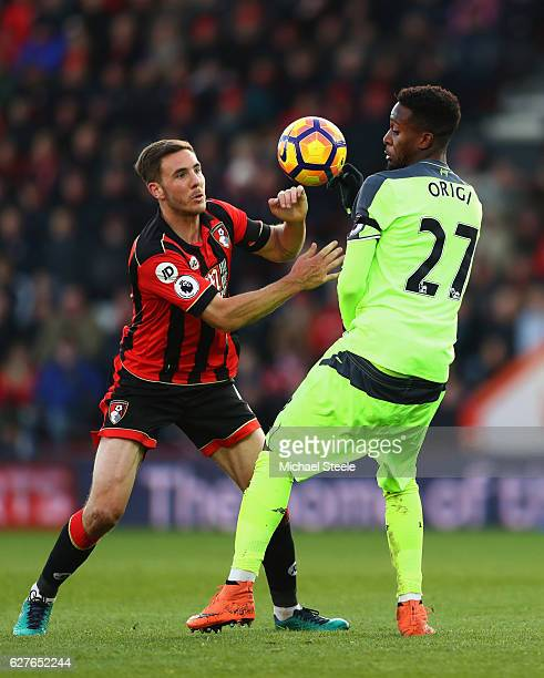 Dan Gosling of AFC Bournemouth and Divock Origi of Liverpool watch the ball during the Premier League match between AFC Bournemouth and Liverpool at...