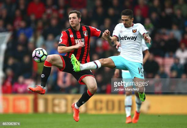 Dan Gosling of AFC Bournemouth and Manuel Lanzini of West Ham United battle for possession during the Premier League match between AFC Bournemouth...