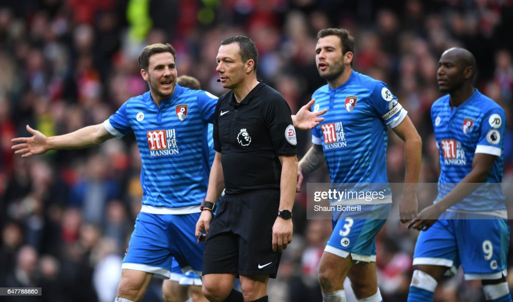 Dan Gosling of AFC Bournemouth (L) appeals to referee Kevin Friend (C) during the Premier League match between Manchester United and AFC Bournemouth at Old Trafford on March 4, 2017 in Manchester, England.